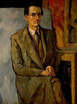 Portrait of artist sitting on chair with partial canvases shown in the background; legs crossed, hands on lap, staring in profile, wearing a blue tie, white shirt, brown vest, brown trench coat, brown slacks, and glasses.