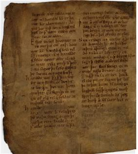 Page of ancient manuscript on weathered, yellowed paper