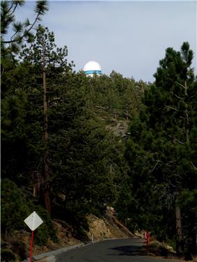 A view of the building of the 2.12m telescope from the road below.