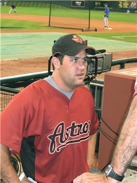 A man in a red baseball jersey with