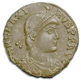 A worn round coin with the profile of a man facing right wearing a thin headband, the inscription MCMAXI MVSPFA surrounding, with other letters worn