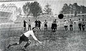 A successful penalty kick, seen from the back of the net