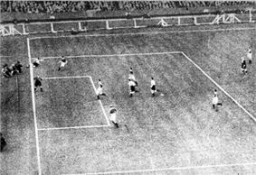 Photo of Richardson (top left) crossing the ball back into the Arsenal penalty box; the ball is fully over the goal-line at the moment he played it.