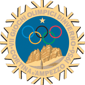A stylized snowflake with the Olympic rings, a star and mountains. Surrounding the perimeter of the snow flake are the words,