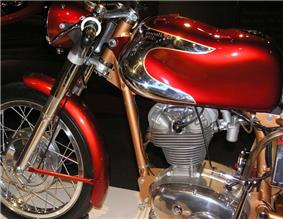 The front half of pristine 1960s Italian single-cylinder motorcycle with polished chrome accents on the so-called