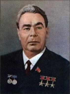 A man with greying hair, in military uniform with five medals