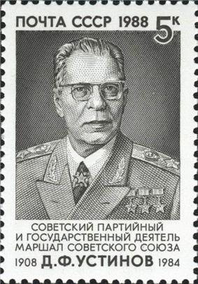 A man wearing glasses dressed in his military uniform