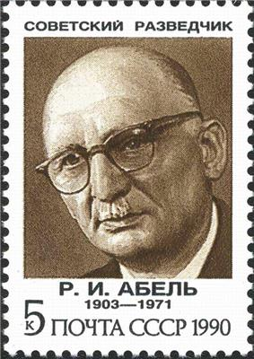 A reproduction of a stamp showing a drawing of a balding elderly man wearing glasses