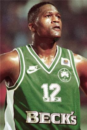 A man, with a Panathinaikos jersey in a game looking up.