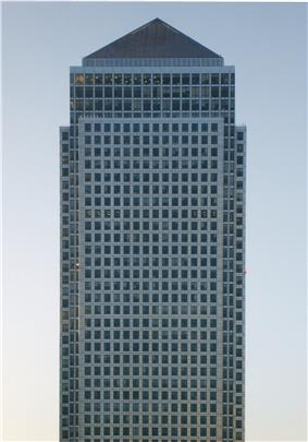 Picture of the Canary Wharf Tower set against a clear blue sky.