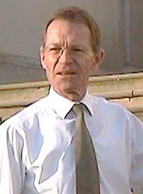 Nicholas Serota, a man wearing a white shirt and a solidly colored tie