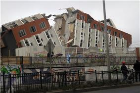 Collapsed building in Concepción.