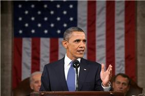 Obama speaks in front of Joe Biden and John Boehner.
