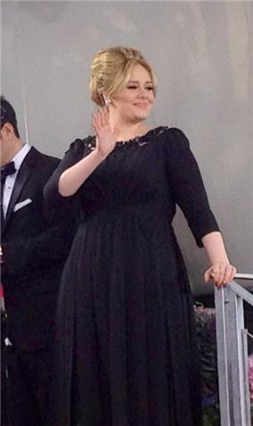 Adele in a black dress.