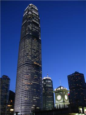 A brightly lit tall skyscraper at night