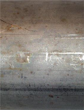 Matte surface of pipe, with a few horizontal scratches