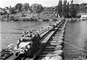 3rd Armored Division vehicles cross the Seine River.jpg