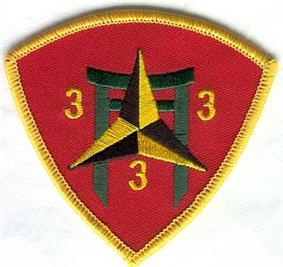 A red shield with a gold border. In the center is a pagoda with a black and gold caltrop over it. In the three corners of the shield are the number
