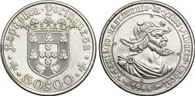 Photograph of a silver-colored 1968 coin with a profile of a bearded man on the obverse and a coat of arms on the reverse