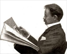 A Victorian man of middle age, with a moustache, seated, reading a newspaper, viewed in profile from his left