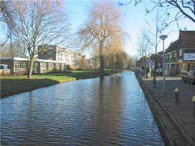 Straight canal with buildings on both sides