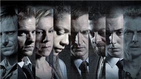 Faces of eight cast members, slightly grey and colourless, all looking serious and ahead or lower, shown side-by-side in eight vertical bands.