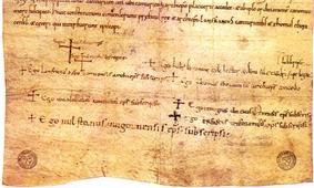 Bottom of a manuscript with several signatures below a block of handwritten text.