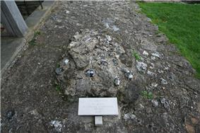 Pile of stones marked with a tag reading