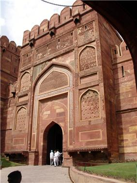 Decorated gate to a fortress of red stone.