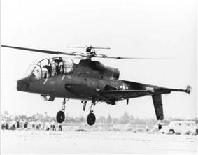 A quarter front view of a Cheyenne hovering in front of a crowd.