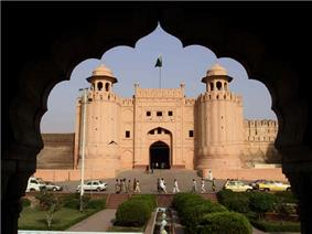 Entrance gate to a fort flanked by two large towers.
