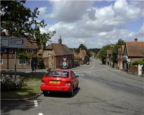 View of a village street lined with red brick buildings