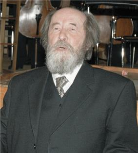 Aleksandr Solzhenitsyn with his mouth open and lower teeth on show