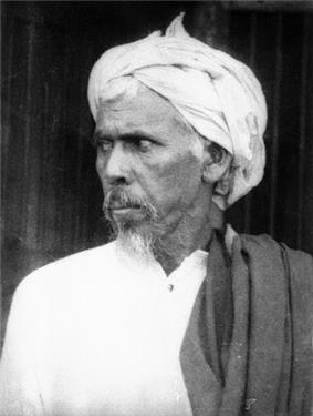Older man in traditional dress, looking left