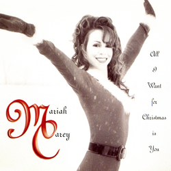 Image shows Carey wearing a Santa suit, while posing in an upright position. She has long brown curly hair, and is smiling. The background imagery is beige, with red letters that spell out the song's title.