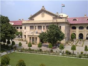 Large building behind landscaped grounds