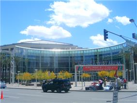photo showing the semi-circular entrance to the America West Arena in downtown Phoenix, blue sky in background