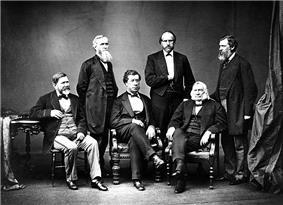 Studio black and white portrait of American High Commissioners. Sec. Hamilton Fish seated in center.