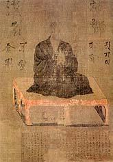 A priest seated on a pedestal in three-quarter view.