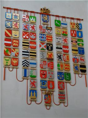 Coats of arms corresponding to the titles borne by various Dutch monarchs, including Veere and Flushing (right above the bottom crowned arms), displayed at Nieuwe Kerk in Amsterdam