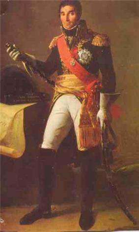 Formal full-length portrait of Masséna in dress military uniform, comprising white breeches with knee length black boots, dark cutaway coat with high collar and gold embroidery, a red shoulder sash and gold waist sash. He wears a large star of honor on his breast. He is a tall dark man with a long face and thick eyebrows. He looks quizzically at the observer and holds a marshal's baton, and saber.