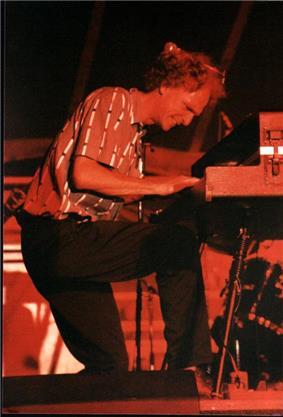 Pratt playing a keyboard