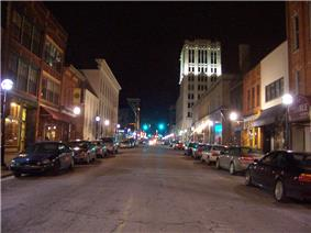Night time in downtown, with buildings lit by street lamps