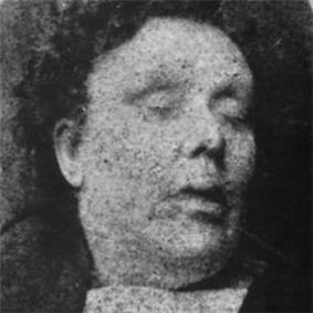 Mortuary photograph of Chapman: a middle-aged woman with short, curly hair