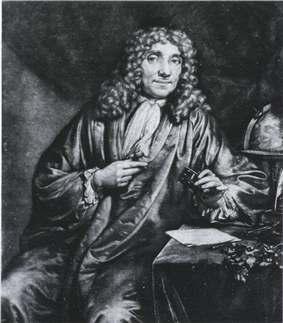A man wearing a long, curly wig and a full robe is sitting, looking out. His left arm rests on a small table, with his left hand holding a box. Behind him is a globe.
