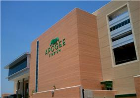 A large, contemporary structure with a light green logo that says