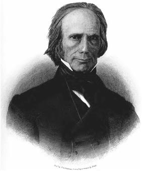A man with thinning gray hair wearing a black jacket and time and white shirt