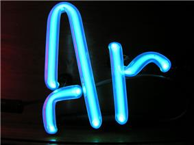 Illuminated light blue gas discharge tubes shaped as letters A and r
