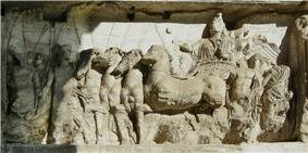 Bas-relief of Roman driver in four-horse chariot, facing left