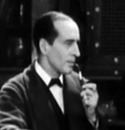 Arthur Wontner as Sherlock Holmes in The Sleeping Cardinal